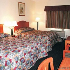 Отель Americas Best Value Inn & Suites-Bush Int'l Airport комната для гостей фото 3