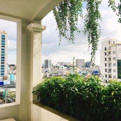 Отель Lotus SaiGon Hotel Вьетнам, Хошимин - отзывы, цены и фото номеров - забронировать отель Lotus SaiGon Hotel онлайн балкон