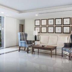 Отель Dlux Condominium Таиланд, Бухта Чалонг - отзывы, цены и фото номеров - забронировать отель Dlux Condominium онлайн интерьер отеля