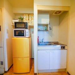 Апартаменты Hakata Apartment Хаката в номере фото 2