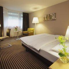 Mövenpick Hotel München-Airport комната для гостей фото 8