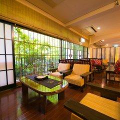 Отель Kinosato Yamanoyu Япония, Минамиогуни - отзывы, цены и фото номеров - забронировать отель Kinosato Yamanoyu онлайн интерьер отеля фото 2