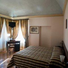 Отель San Claudio Корридония сейф в номере