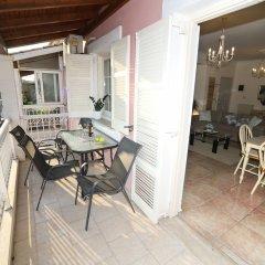 Отель Philoxenia Family Suite Греция, Корфу - отзывы, цены и фото номеров - забронировать отель Philoxenia Family Suite онлайн балкон