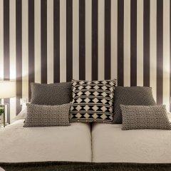 Отель Apartamentos Casa Malasaña Испания, Мадрид - отзывы, цены и фото номеров - забронировать отель Apartamentos Casa Malasaña онлайн комната для гостей фото 2