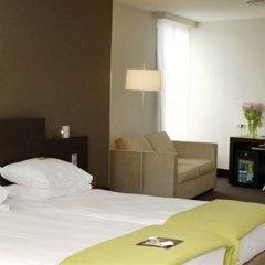 Отель NH Amsterdam Caransa 4* Улучшенный номер с различными типами кроватей фото 2