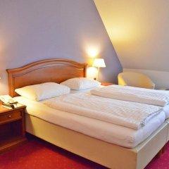 Отель am Mirabellplatz Австрия, Зальцбург - 5 отзывов об отеле, цены и фото номеров - забронировать отель am Mirabellplatz онлайн комната для гостей фото 2