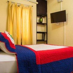 Отель Terrabella 16 by Pro Homes Jamaica сейф в номере
