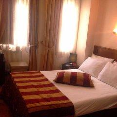 Abella Hotel комната для гостей