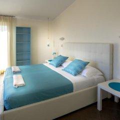 Отель Residence Amarcord Италия, Римини - отзывы, цены и фото номеров - забронировать отель Residence Amarcord онлайн комната для гостей фото 3
