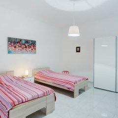 Отель Seafront Apartment in Sliema wt Breathtaking Views Мальта, Слима - отзывы, цены и фото номеров - забронировать отель Seafront Apartment in Sliema wt Breathtaking Views онлайн комната для гостей фото 3