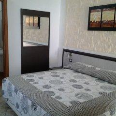 Отель La Rosa Синискола сейф в номере