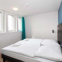 Отель A&O Prague Rhea комната для гостей