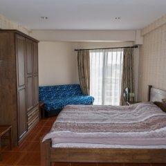 Отель Jomtien Beach Condominium Паттайя комната для гостей фото 3