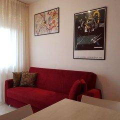 Апартаменты Sunset Apartment Римини комната для гостей фото 3