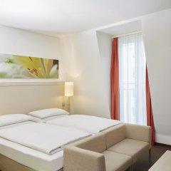 Отель H+ Hotel München Германия, Мюнхен - отзывы, цены и фото номеров - забронировать отель H+ Hotel München онлайн комната для гостей