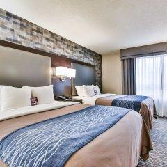 Отель Comfort Inn Montréal Aéroport Канада, Монреаль - отзывы, цены и фото номеров - забронировать отель Comfort Inn Montréal Aéroport онлайн комната для гостей фото 4