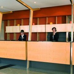 Отель NH Leipzig Messe фитнесс-зал фото 3