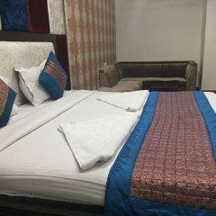 Отель Apra International Индия, Нью-Дели - отзывы, цены и фото номеров - забронировать отель Apra International онлайн комната для гостей фото 4