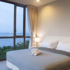 Отель Beachfront Sea View Baan Plai Haad Паттайя комната для гостей