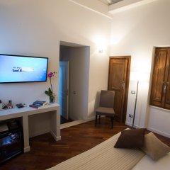 Отель Relais Arco Della Pace удобства в номере