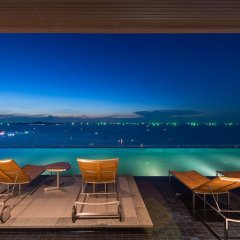 Отель 1Br Centric Sea 812 With Infinity Pool Паттайя гостиничный бар