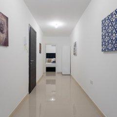 Отель Saint Julian's - Spinola Bay Apartment Мальта, Сан Джулианс - отзывы, цены и фото номеров - забронировать отель Saint Julian's - Spinola Bay Apartment онлайн интерьер отеля фото 3
