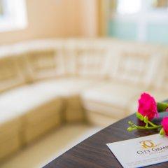 Отель City Grand Мале комната для гостей