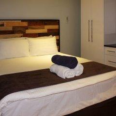 Апартаменты Greystone Apartments 01 комната для гостей