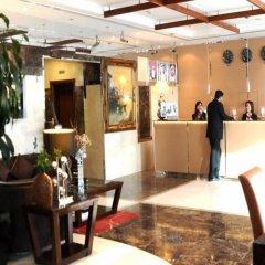 Legacy Hotel Apartments интерьер отеля