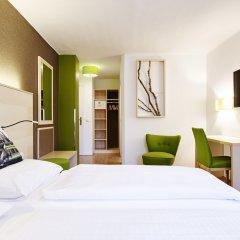 Отель Das Grüne Hotel zur Post - 100 % BIO Австрия, Зальцбург - отзывы, цены и фото номеров - забронировать отель Das Grüne Hotel zur Post - 100 % BIO онлайн комната для гостей фото 3
