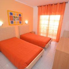 Отель Apartamentos Cravinho Португалия, Албуфейра - отзывы, цены и фото номеров - забронировать отель Apartamentos Cravinho онлайн комната для гостей фото 2
