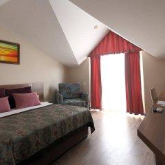 Отель Crystal Aura Beach Resort & Spa – All Inclusive комната для гостей фото 4