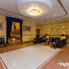 Отель Rolla Residence ОАЭ, Дубай - отзывы, цены и фото номеров - забронировать отель Rolla Residence онлайн интерьер отеля фото 2
