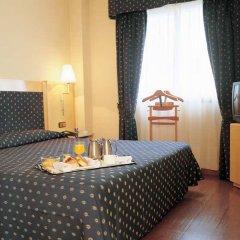 NH Suites Prisma Hotel в номере