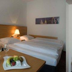 Отель ARCOTEL Castellani Salzburg в номере фото 2