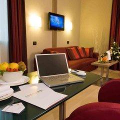 Отель Cosmopolitan Bologna удобства в номере