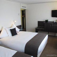 Отель Crowne Plaza Zürich Цюрих комната для гостей фото 2