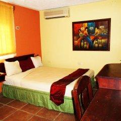 Отель Suites Los Jicaros сейф в номере