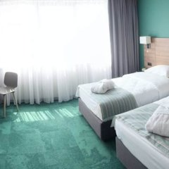 Favor Park Hotel комната для гостей