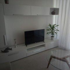 Апартаменты The Edge Apartment комната для гостей фото 3