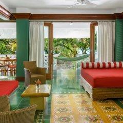 Отель Idle Awhile Resort Ямайка, Саванна-Ла-Мар - отзывы, цены и фото номеров - забронировать отель Idle Awhile Resort онлайн интерьер отеля фото 2