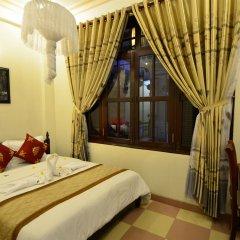 Отель Nhi Nhi Хойан комната для гостей фото 2