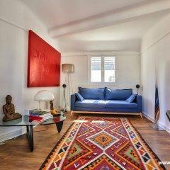 Апартаменты Cozy Apartment next to Eiffel Tower комната для гостей фото 2