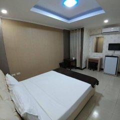 Отель OYO 700 Pj Inn Hotel Филиппины, Пампанга - отзывы, цены и фото номеров - забронировать отель OYO 700 Pj Inn Hotel онлайн комната для гостей фото 2
