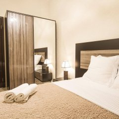Отель Tbilisi Core: Aquarius Apartment Грузия, Тбилиси - отзывы, цены и фото номеров - забронировать отель Tbilisi Core: Aquarius Apartment онлайн комната для гостей фото 5