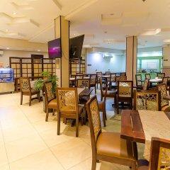 Отель Microtel Inn And Suites Davao Филиппины, Давао - отзывы, цены и фото номеров - забронировать отель Microtel Inn And Suites Davao онлайн питание