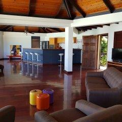 Отель Villa Riviera - Tahiti Французская Полинезия, Пунаауиа - отзывы, цены и фото номеров - забронировать отель Villa Riviera - Tahiti онлайн интерьер отеля фото 2