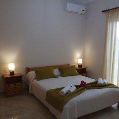 Апартаменты Sunset Relax Apartments комната для гостей фото 5