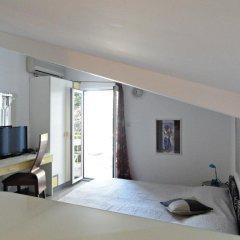 Отель Sun Rose Apartments Черногория, Свети-Стефан - отзывы, цены и фото номеров - забронировать отель Sun Rose Apartments онлайн комната для гостей фото 5